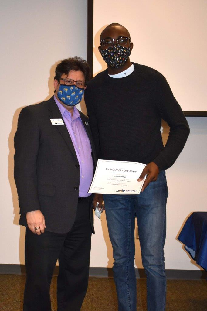student with college president at dean's list celebration