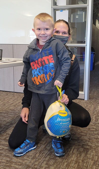 Jamie Redding and her Son receive Thanksgiving meal