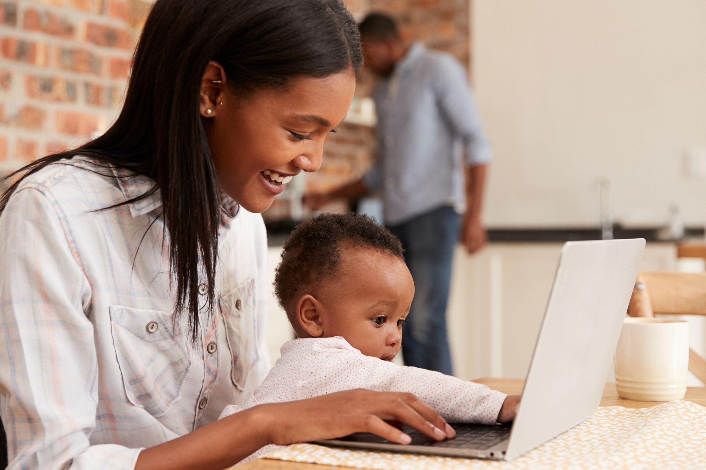 girl and child at computer
